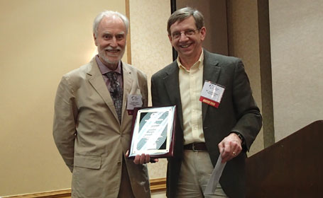 Ken Liechti receiving Adhesion Award