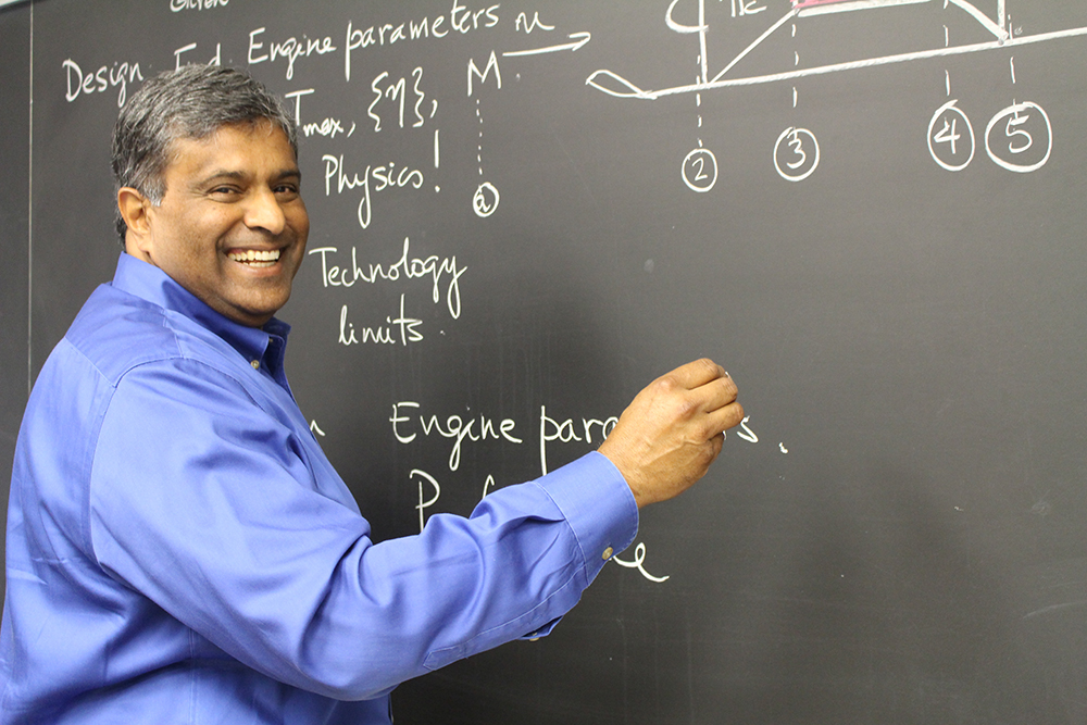 Philip Varghese at chalkboard