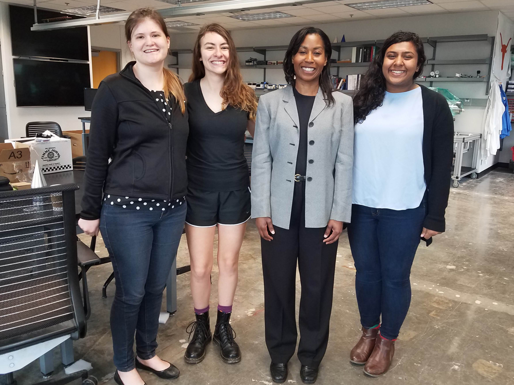 photo of alumna stephanie wilson with students in lab