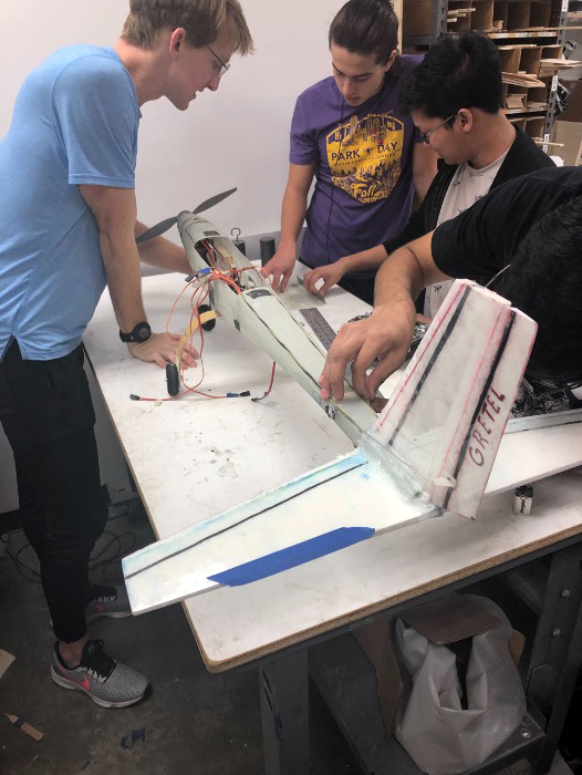 photo of dbf students working on airplane