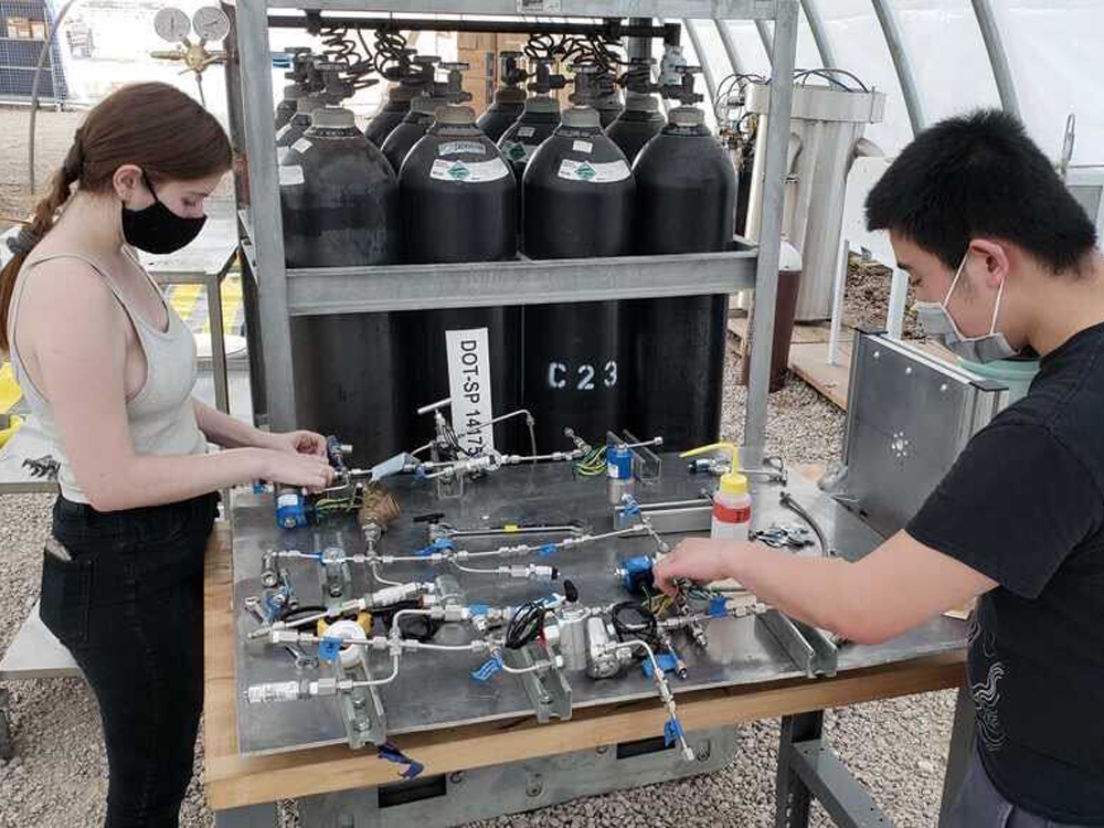photo of students working on TREL ignitor test stand
