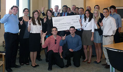 group posing with large check from Lockheed Martin