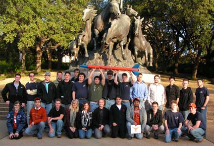 lra group posing in front of horse statue on UT campus in 2010